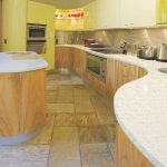 kitchen with curved hanex countertop
