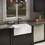 kitchen with corian countertops and corian sink