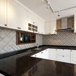 kitchen with hanex black montes solid surface countertops