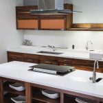 modern kitchen with white hanex solid surface countertops