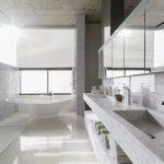 Sunny modern bathroom with hanex countertops