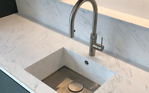 white solid surface kitchen countertop by meganite