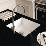 corian sink with black solid surface countertop